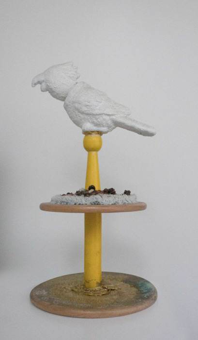 Presidente, 2010. bobble bird, wooden toy, sugar, gesso, gold pigment, tea.